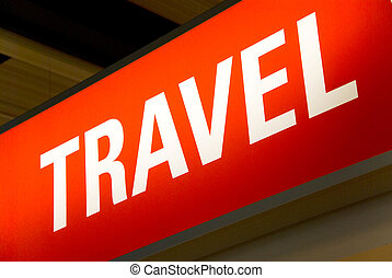 travel sign - red illuminated sign with the word travel