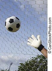goalkeeper's hands reaching foot ball - goalkeeper's hands...