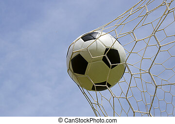 foot ball in the goal net - Soccer foot ball in the goal net