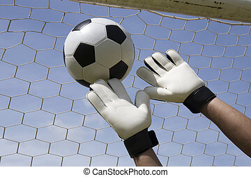 goalkeeper reaching for the foot ball - goalkeeper's...