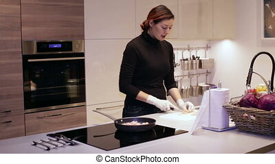 Woman Cuts of Chicken Fillet - Kitchen, Woman Cuts of...