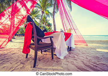 Romantic dinner setting on the tropical beach and sea -...