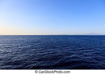 Endless deep blue see - View on still dark blue sea with...
