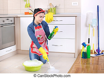 Woman cleaning kitchen floor - Satisfied and pleasant...
