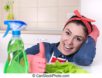 Cleaning lady showing thumb up - Smiling young cleaning lady...
