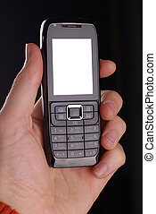 male hand with mobile - male hand holding mobile telephon at...