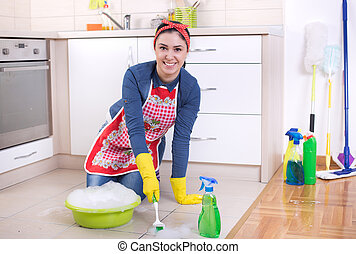 Woman cleaning kitchen floor - Satisfied woman scrubbing...