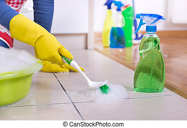 Woman cleaning kitchen floor - Close up of female hands with...