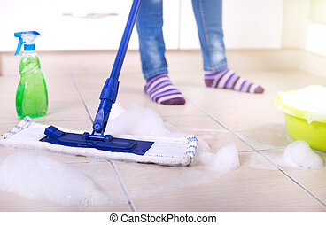 Woman mopping kitchen floor - Close up of mop on kitchen...