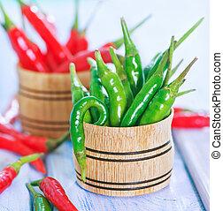 chilli - green and red chilli peppers on a table