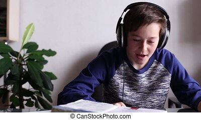 Boy Listening Music in Headphones and Singing
