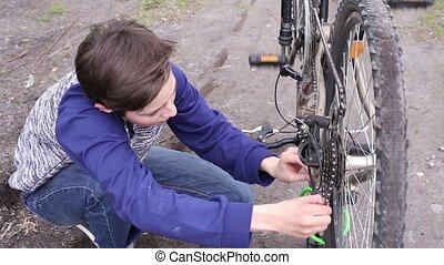 Boy Repairing the Bicycle - Teen Boy Repairing the Bicycle