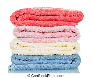 Four of terry towels different colors isolated on white. -...