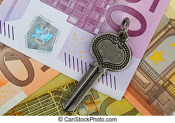 Old vintage key on Euro currency notes