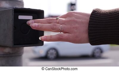 A Woman Pushes A Button Switching Traffic