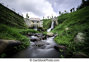 beautiful scenery of hidden waterfall with cloudy sky in the...