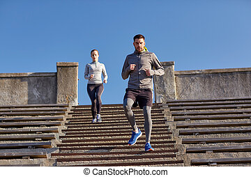 couple running downstairs in city - fitness, sport, people...