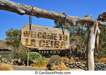 "old vintage wood signboard with text "" welcome to La..."