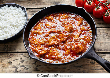 Traditional chicken tikka masala Asian national spicy meat...