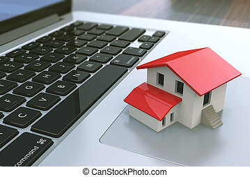 Small house on laptop keyboard. Real estate agency online....