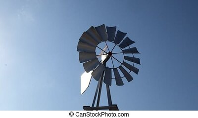 Spinning windmill on background of blue sky in Cyprus
