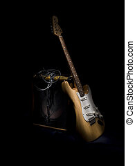 Electric Guitar leaning on amp - This is an electric guitar...