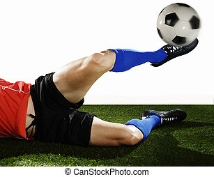 close up legs and soccer shoe of football player in action doing tackle and kicking ball