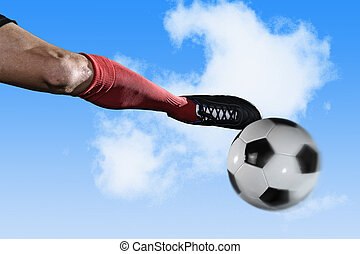 close up leg and soccer shoe of football player kick ball isolated on blue sky with clouds
