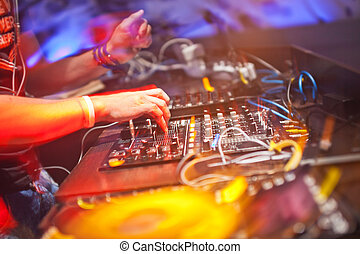 DJ mixing music on console at the night club