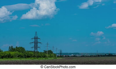 clouds in the sky, rural field plowed earth electricity poles power time period nature tree agriculture clouds sun wind electric wires mains summer spring grass ecology energy energy infrastructure platform 3