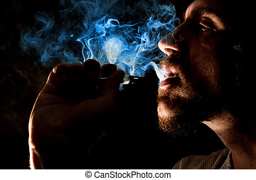 Vaping Bearded Man - Dramatic lighting bearded man smokes a...