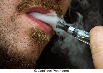 Vaping Bearded Man - Bearded man smokes a vape e-cigarette...