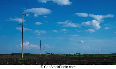 clouds in the sky, rural field plowed earth electricity...