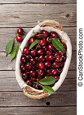 Ripe cherry on wooden table. Top view
