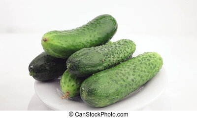 cucumbers on a white plate rotate