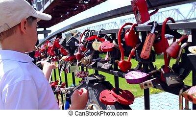 child hang a padlock of love - happy child hang a padlock of...