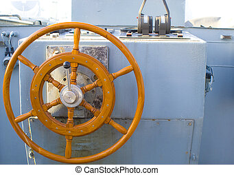 Army Boat Steering wheel - the wooden steering wheel of an...