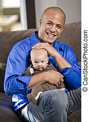 Happy dad with baby sitting on lap - Happy dad with 3 month...