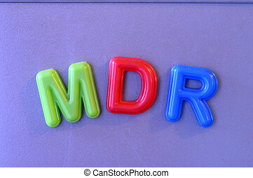 colored magnetic letters - Colored magnetic letters on blue...