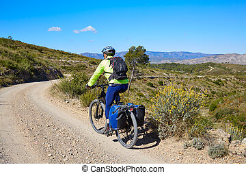 Biker MTB cycle tourism with panniers in Spain - Biker MTB...