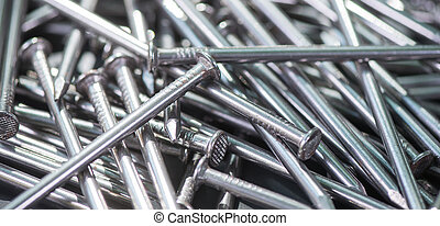 Carpenter long nails on a table closeup