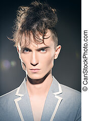 aggressive look - Fashion male model with stylish upright...