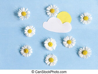 Composition of daisies and paper applications of clouds and sun