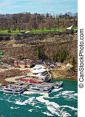 Boats in Niagara River and View of Ontario in Canada....