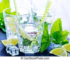 mojito - cold mojito in glass and on a table