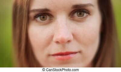 Face of young woman with freckles Close up view - Face of...