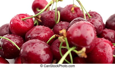 Fresh, ripe, juicy cherries rotate