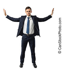 Businessman stands pushing invisible walls by his hands....