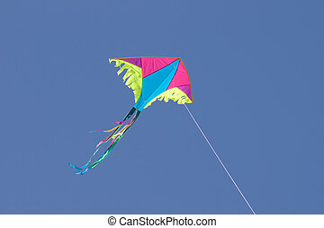 kite in sky - colored kite in blue sky