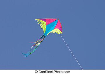 kite in sky - colored kite in blue sky